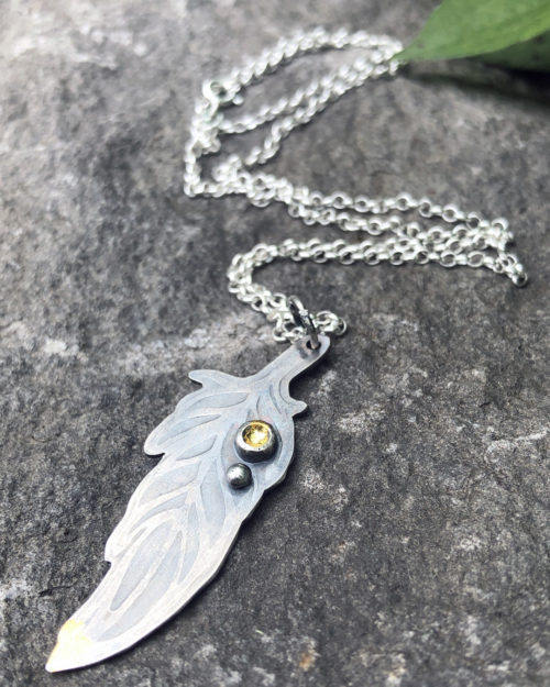 silver and gold feather pendant